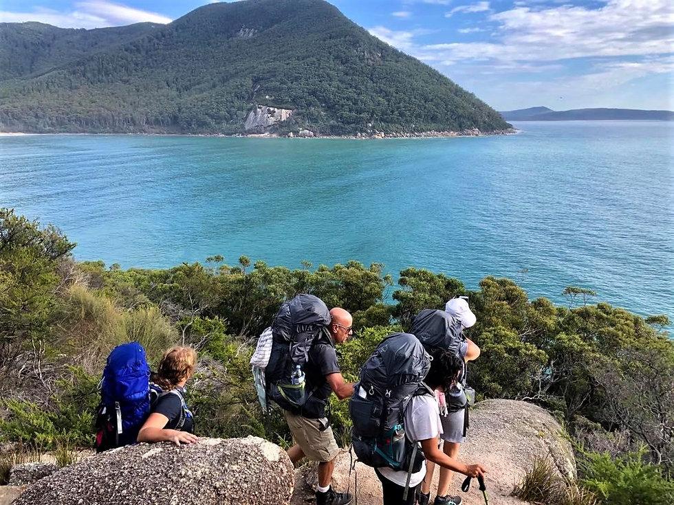 Hikers with packs Refuge Cove WP.jpg