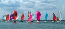 Cowes Week on the water spectating the largest sailing regatta of its kind in the world  with The Salamander Sailing Adventure