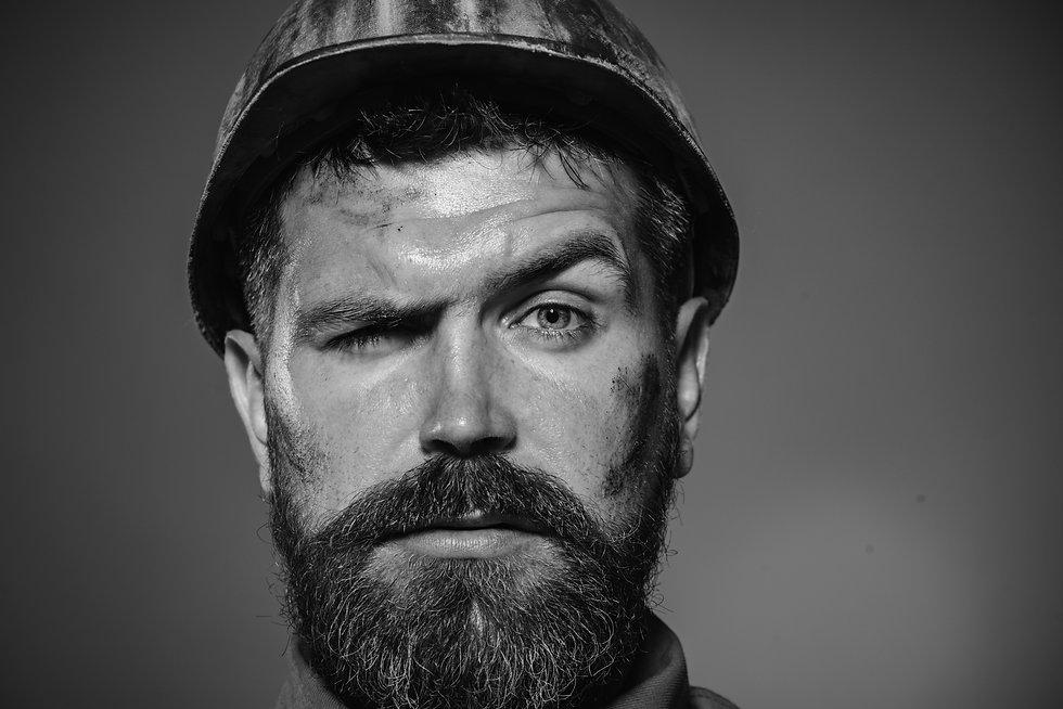 Builder working with construction helmet