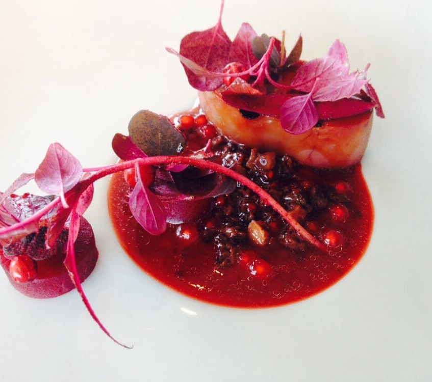 Grilled veal tongue with red leaves and lingon berries.