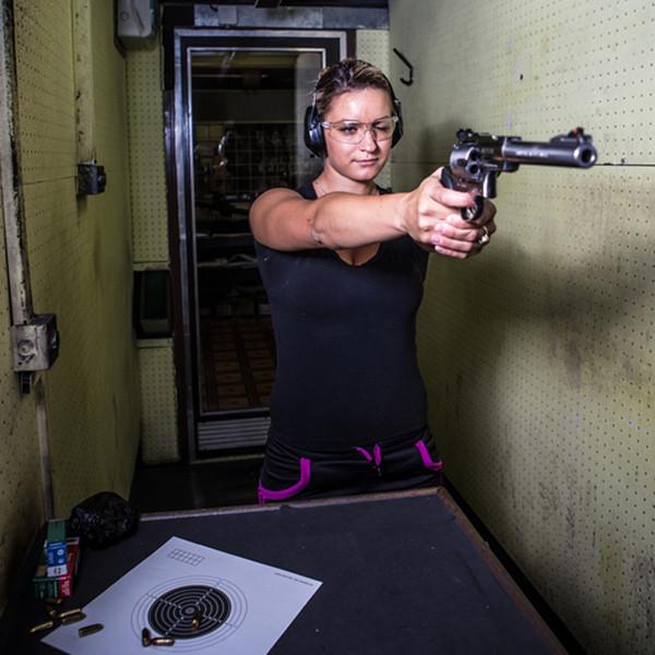 woman shooting at the range