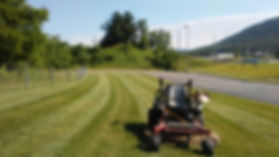 Maintain the appearance of your parking lot with mowing by Northwest Lawn Care