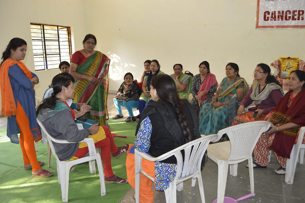 WIN MSW Pooja Atey (sitting left) discussing the programs objectives with GMCH staff