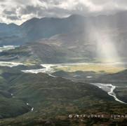 Rain and Sun in Glaciated Valley