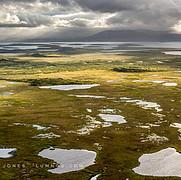 Sunlit Marsh, Shadowed Lake and Mountain