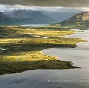 Sunlit Lakeshore, Shadowed Mountains