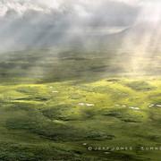 Sunbeams Through Storm Clouds