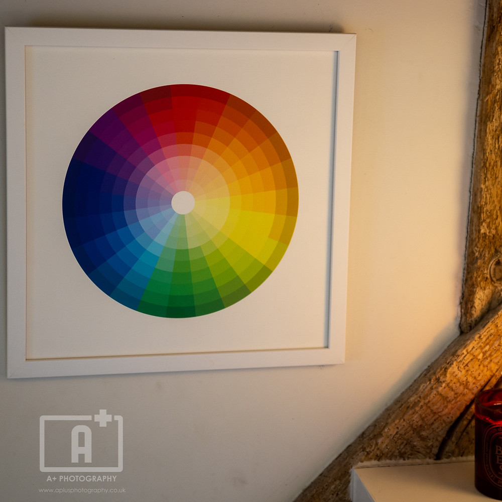 A framed picture of a colour wheel on the wall of a stylist studio in Cookham.