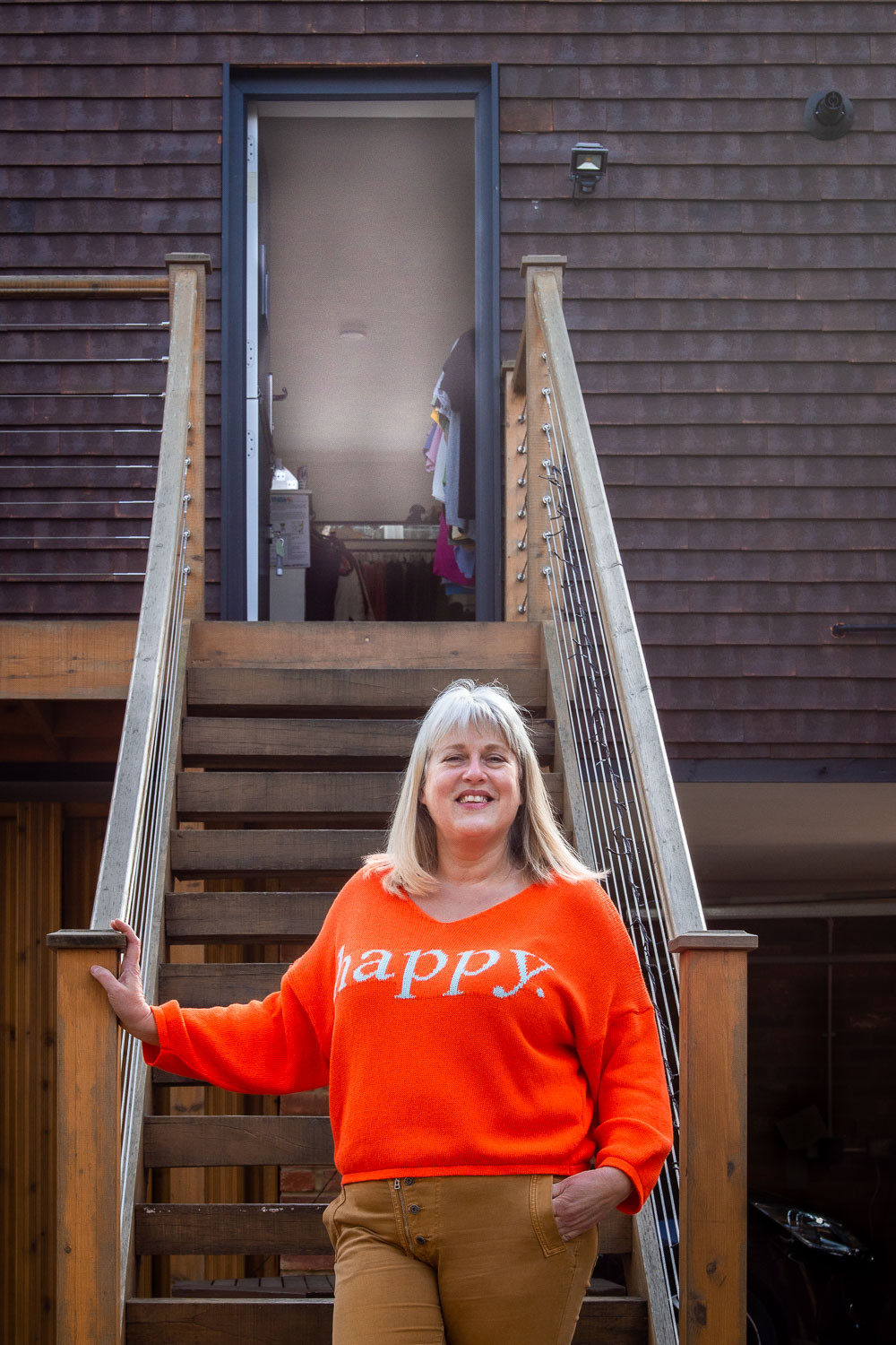 Maidenhead Business Branding Photography | Photo of independent shop owner on stairs in front of open shop door