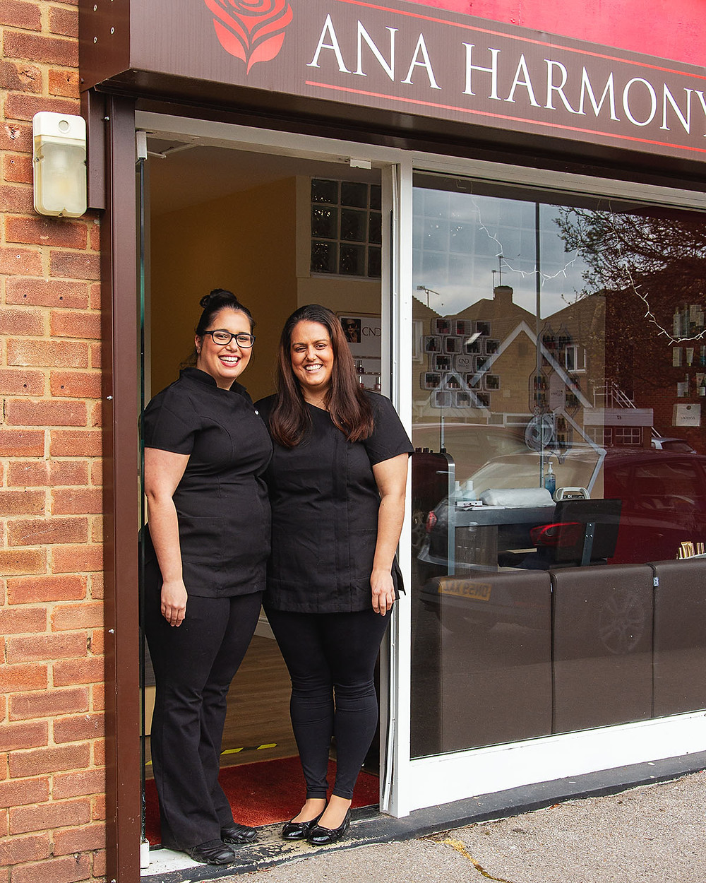 Business photography | Two women in salon uniforms standing in doorway to beauty salon in Maidenhead