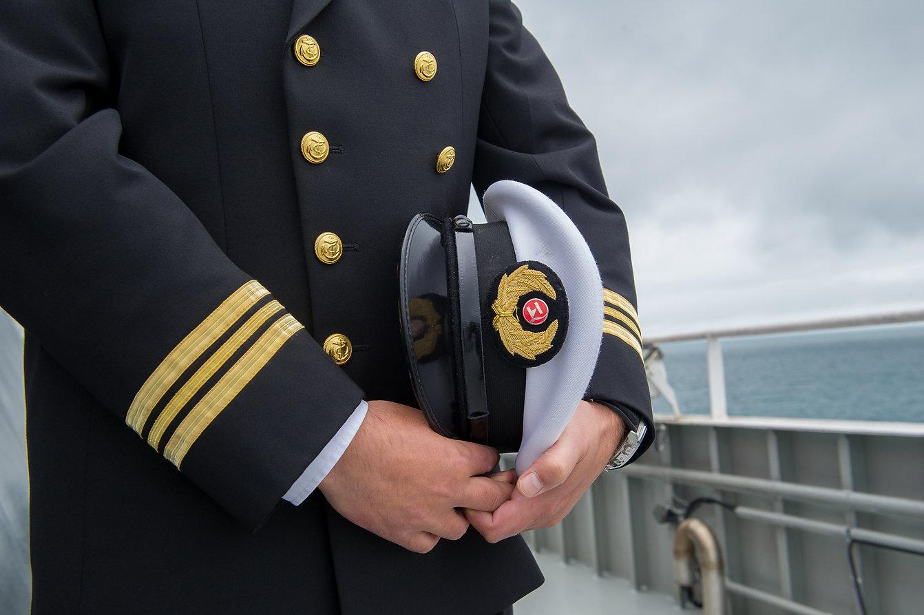 marine sailor holding his hat.jpg