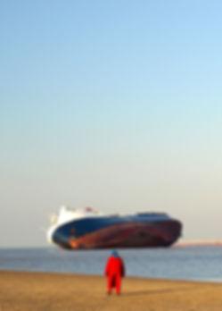 Ship run aground with sightseers.jpg