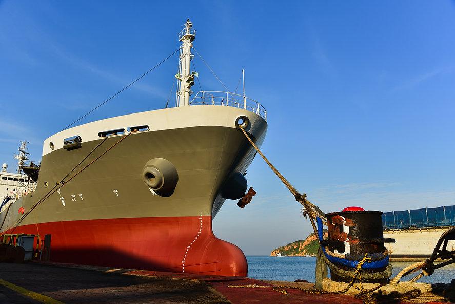 Front tanker ship moored alongside in sh