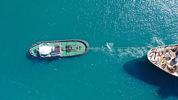 Aerial drone photo of tow boat cruising