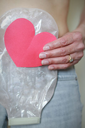 Woman holding a red heart while wearing