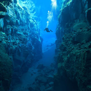 Snorkel between continents in Iceland