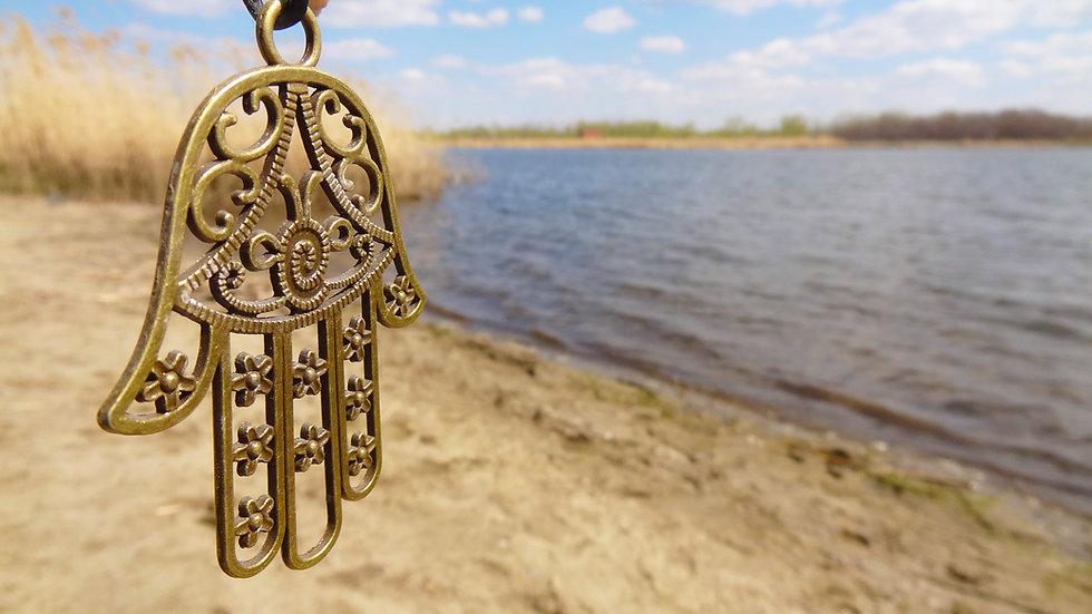 symbol hamsa or hand of Fatima hanging o