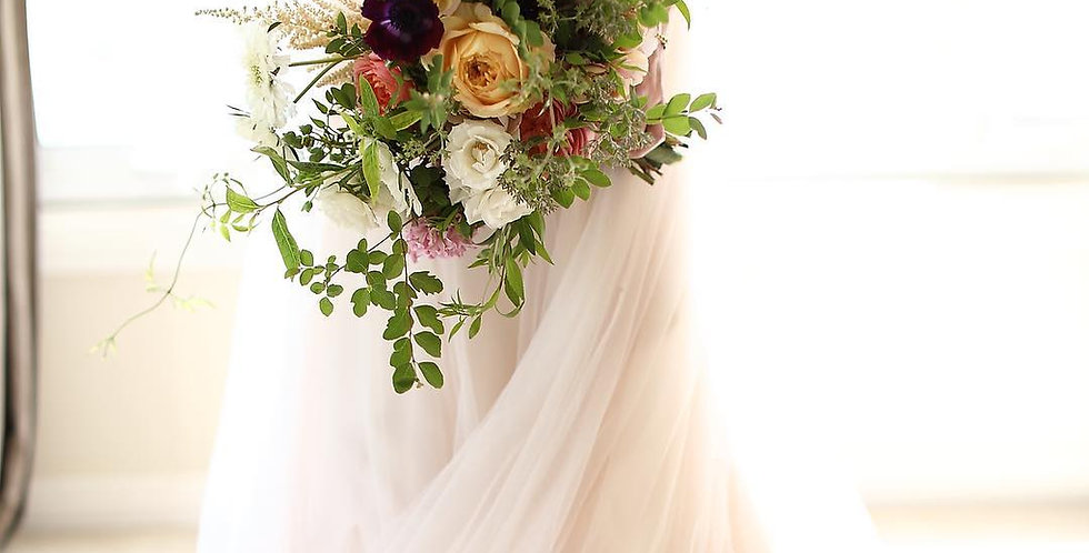 THE BRIDAL BOUQUET AND BOUTONNIERE