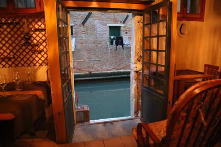 Venice Italy, door to canal