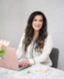 Juliana Laface – Edmonton Graphic Designer & Edmonton Web Design using laptop to perfect graphic design for client