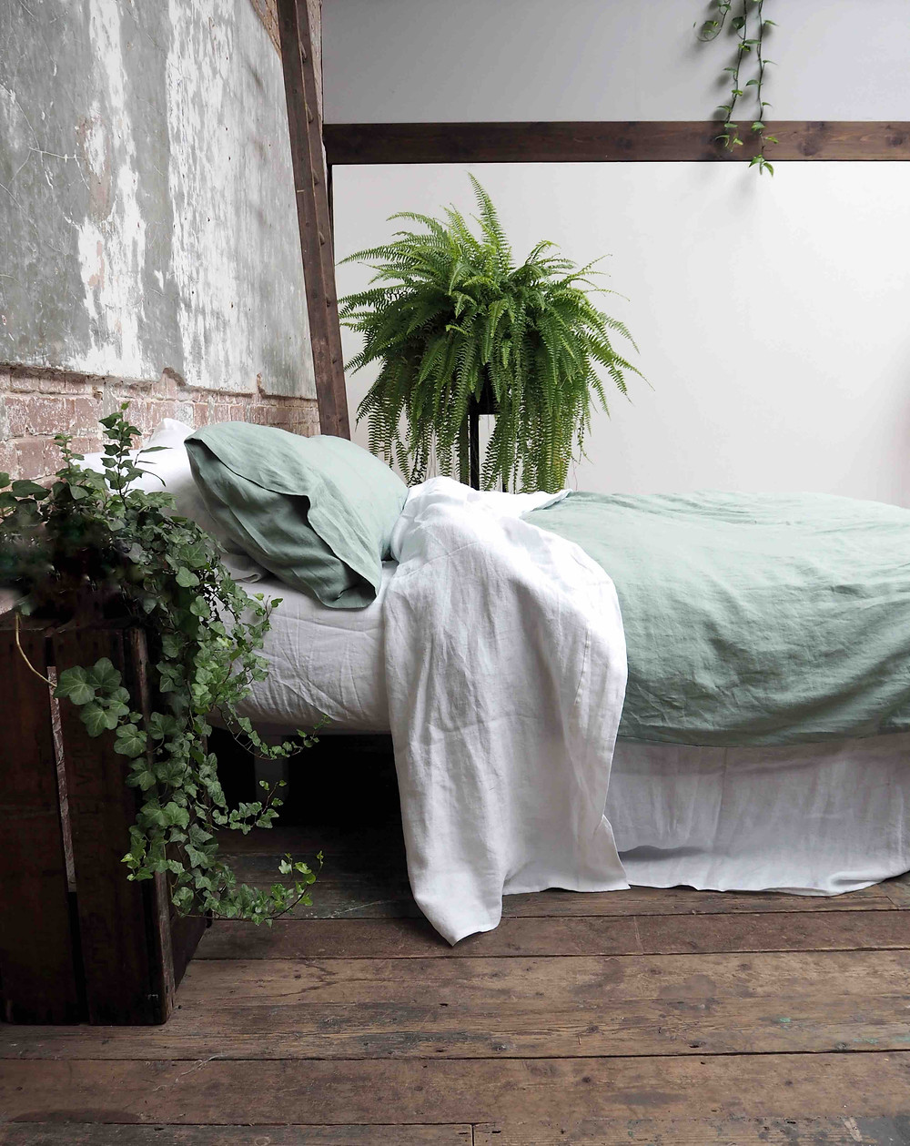 Sage green linen duvet cover from £138, pillowcases £32 for 2, Piglet