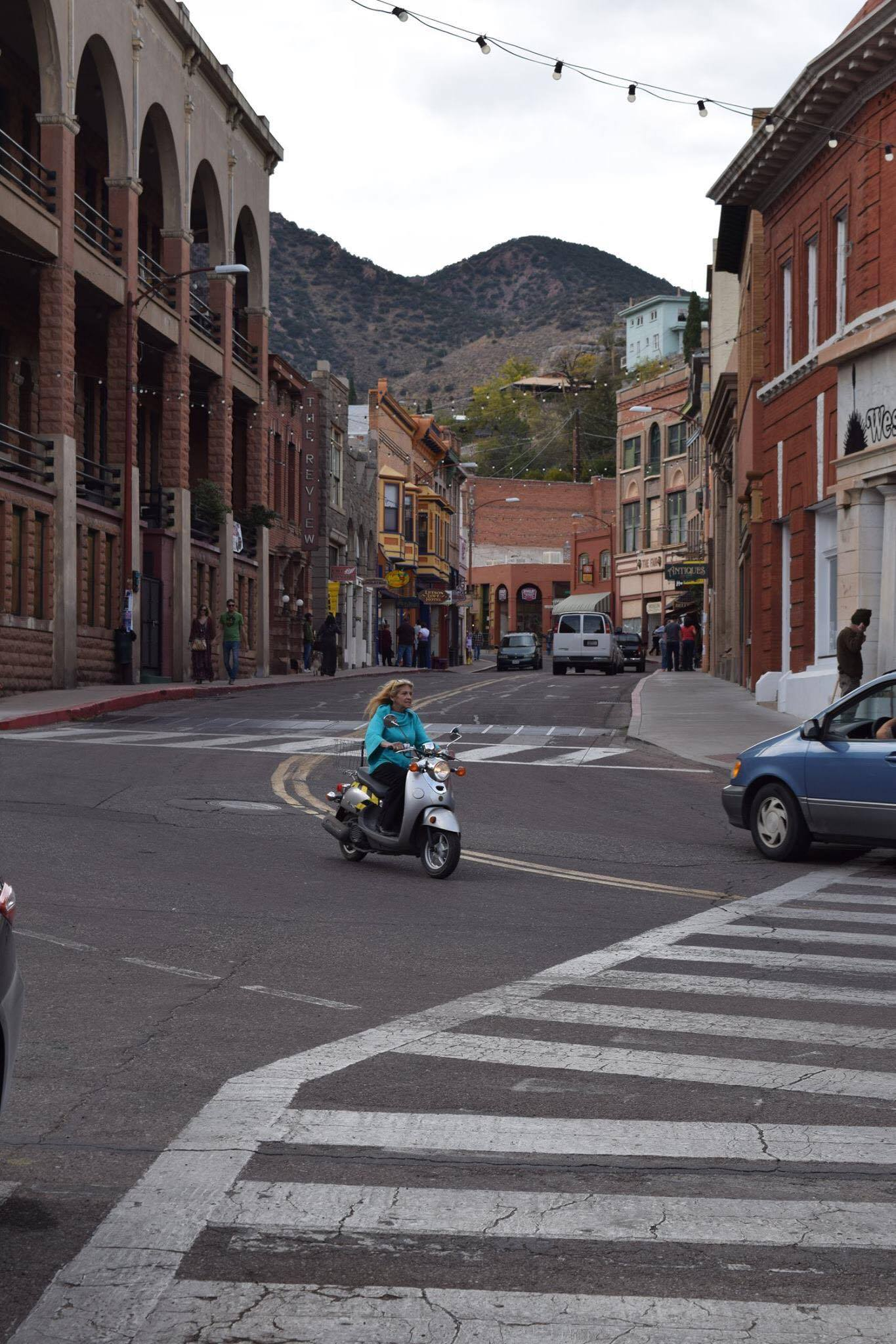 Scooter rider in downtown Old Bisbee