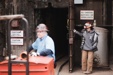 VISITORS EXPERIENCE MINING LIFE AS TOUR DESCENDS INTO DEPTHS OF BISBEE'S COPPER QUEEN MINE