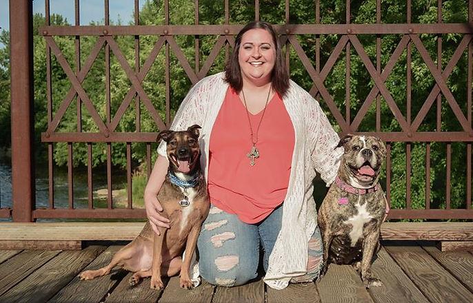 Kayce Lessman, owner of Sokota Bulldogges, with Maximus and Mama Mia