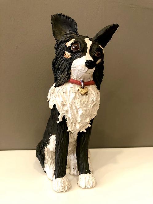 A tall ceramic sculpture of a Dog