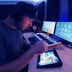 Mack Geary, the producer at Tunes Recording Studio making beats on his digital MPC.