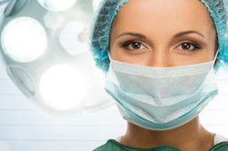 bigstock-young-woman-doctor-in-cap-and-61530965