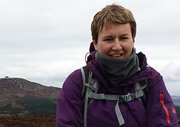 Woman smiling at camera with a mountain in the backgrund