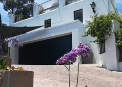 The low maintenance, space saving alternative garage door with extra security.