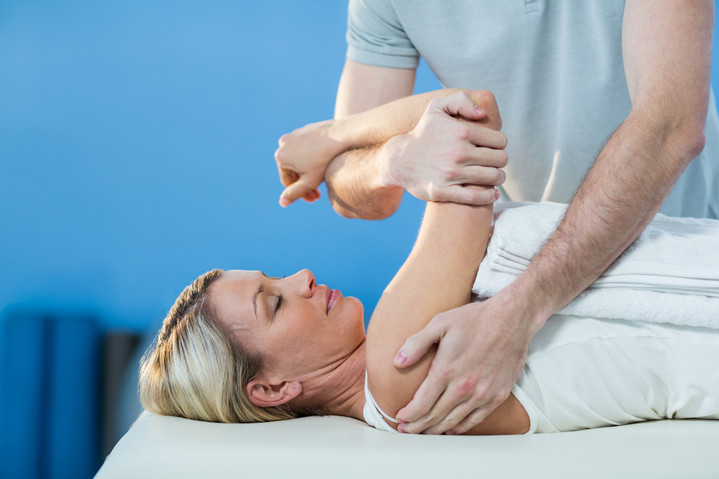 woman-receiving-shoulder-therapy-from-ph