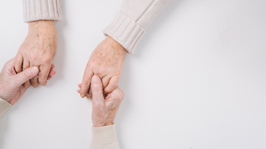 close-up-of-senior-couple-holding-hands.