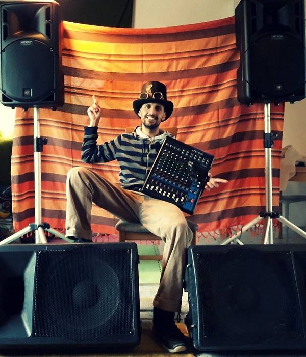 dekel terry with amplification equipment, speakers and mixer