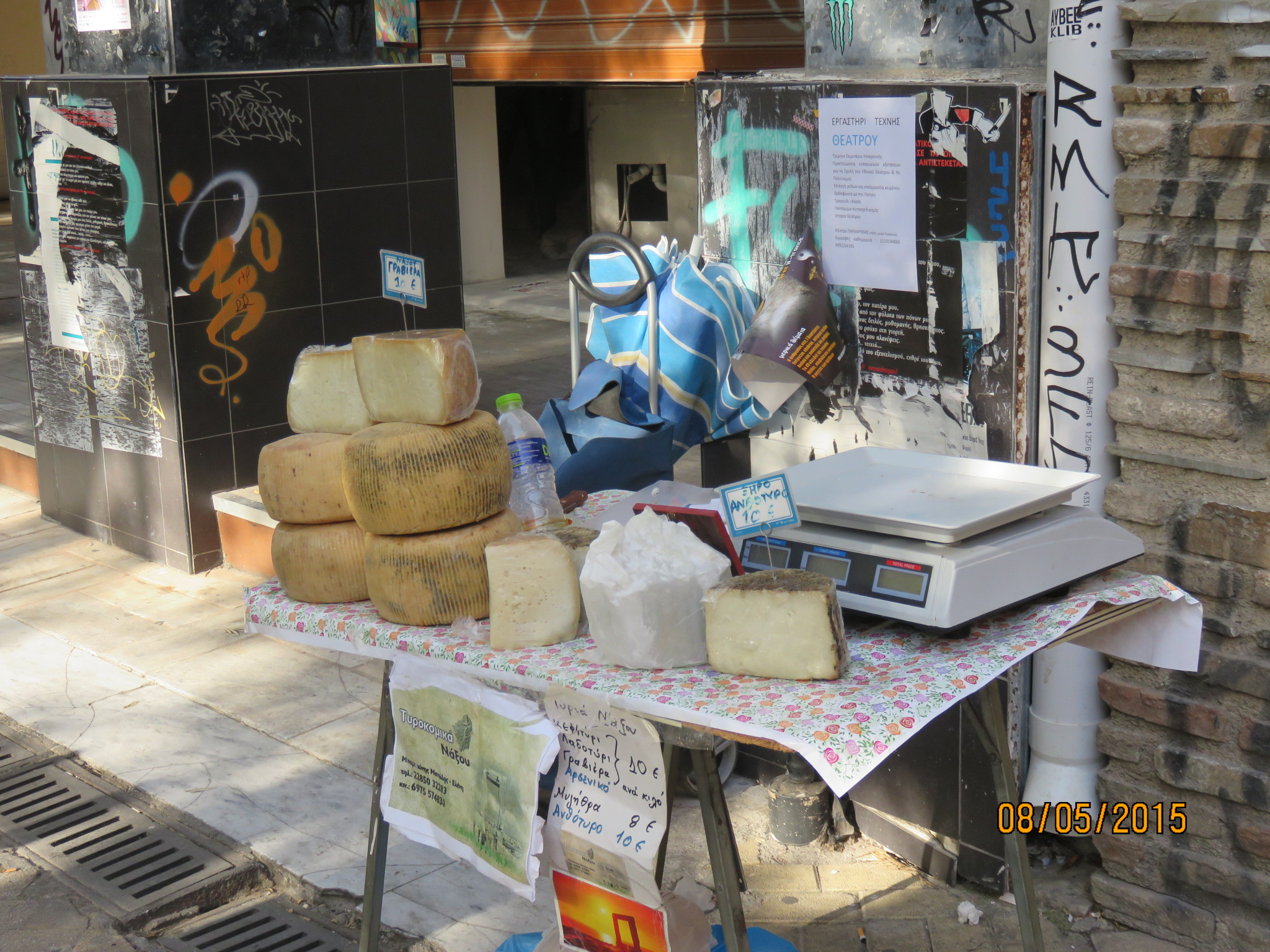 Cheese selling on the sidewalk
