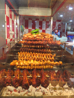 Yards of chicken on a spit