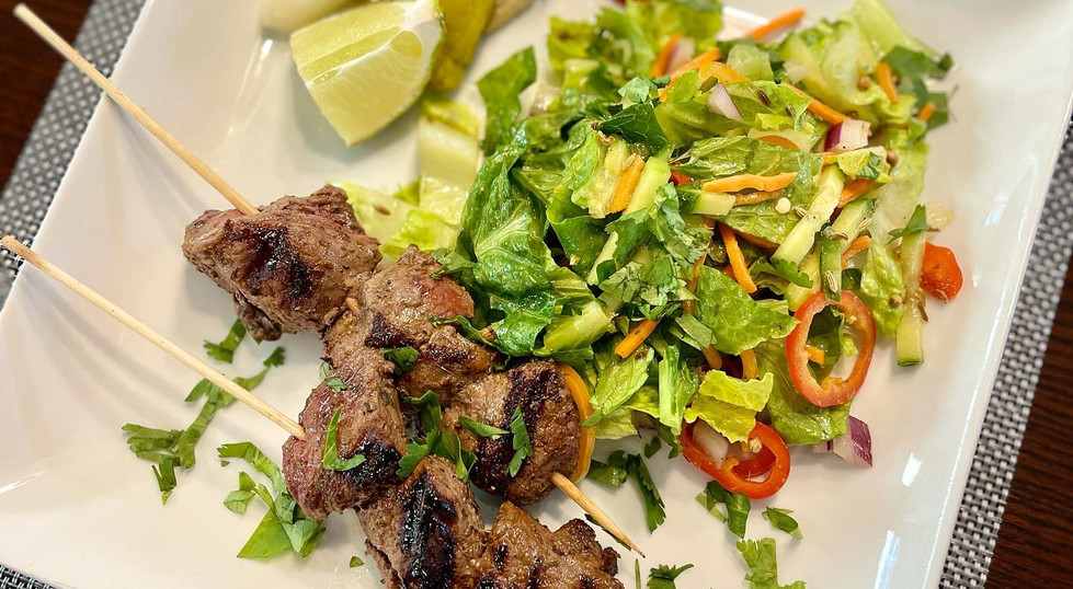 Cumin-spiced beef kebabs and chopped salad with toasted fennel-coriander vinaigrette