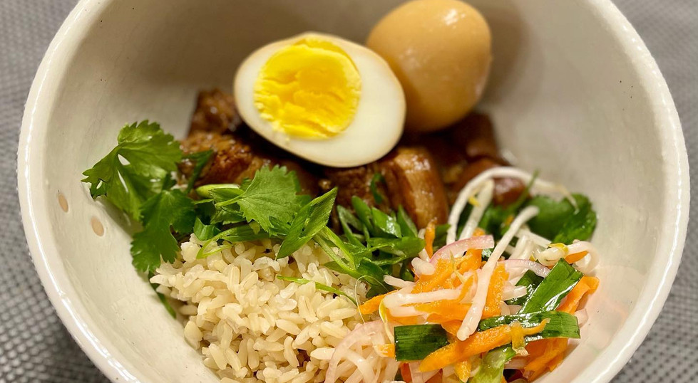 Vietnamese braised pork and eggs with pickled bean sprouts over brown rice