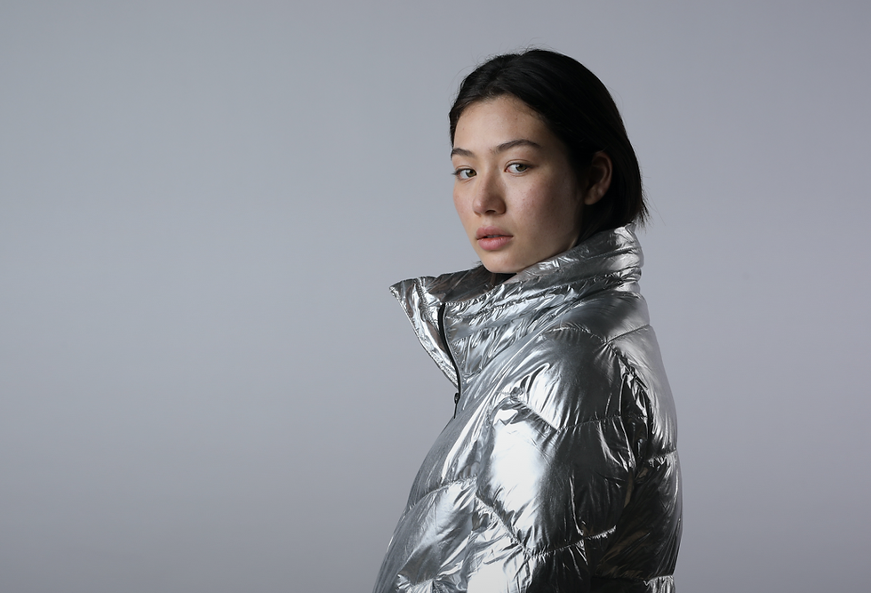 Girl in a shiny silver anorak.
