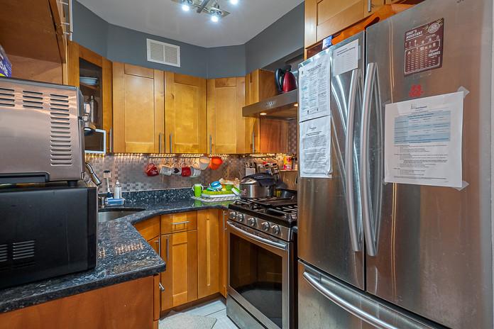 6636 Yellowstone Blvd Unit 9A-print-015-016-Kitchen-2768x1848-300dpi.jpg
