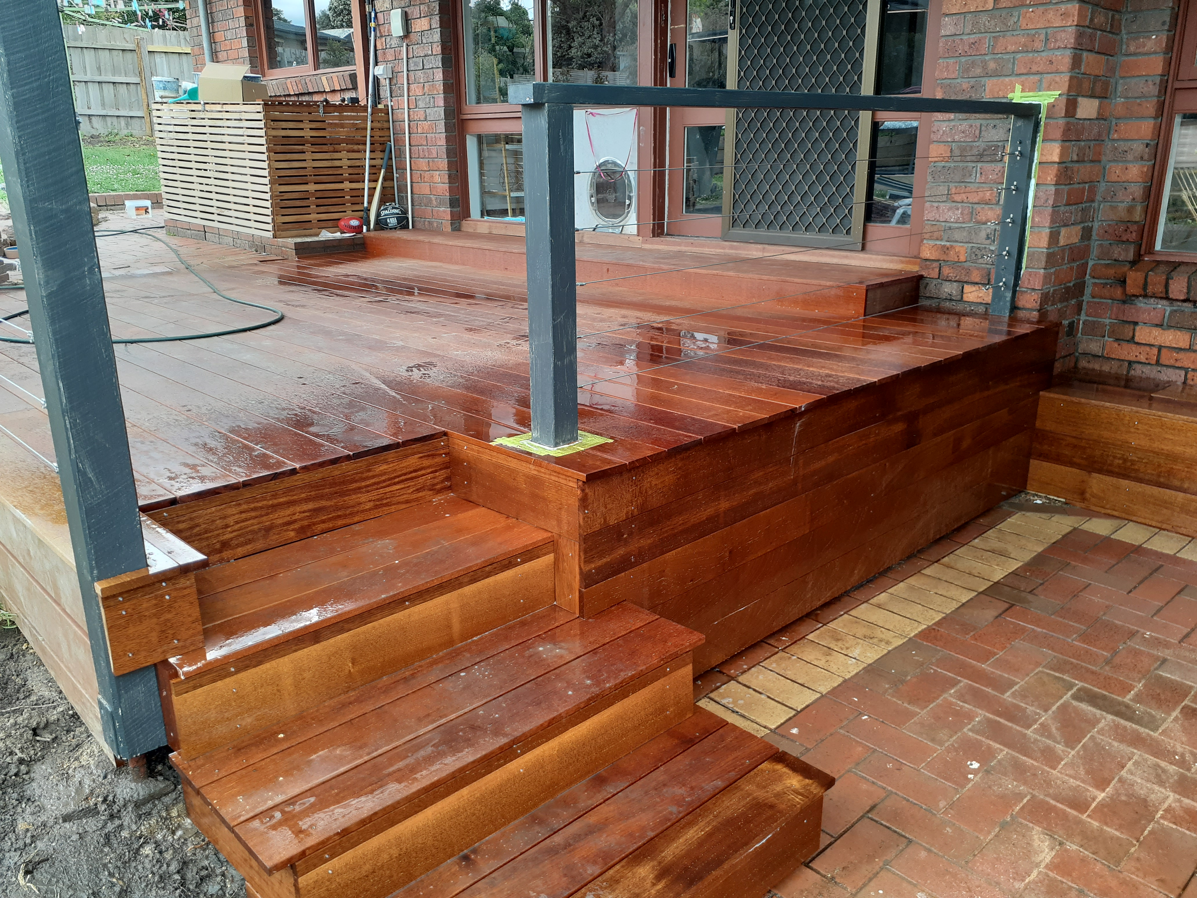 We replaced the sloped brick ramp with a nice Merbau step
