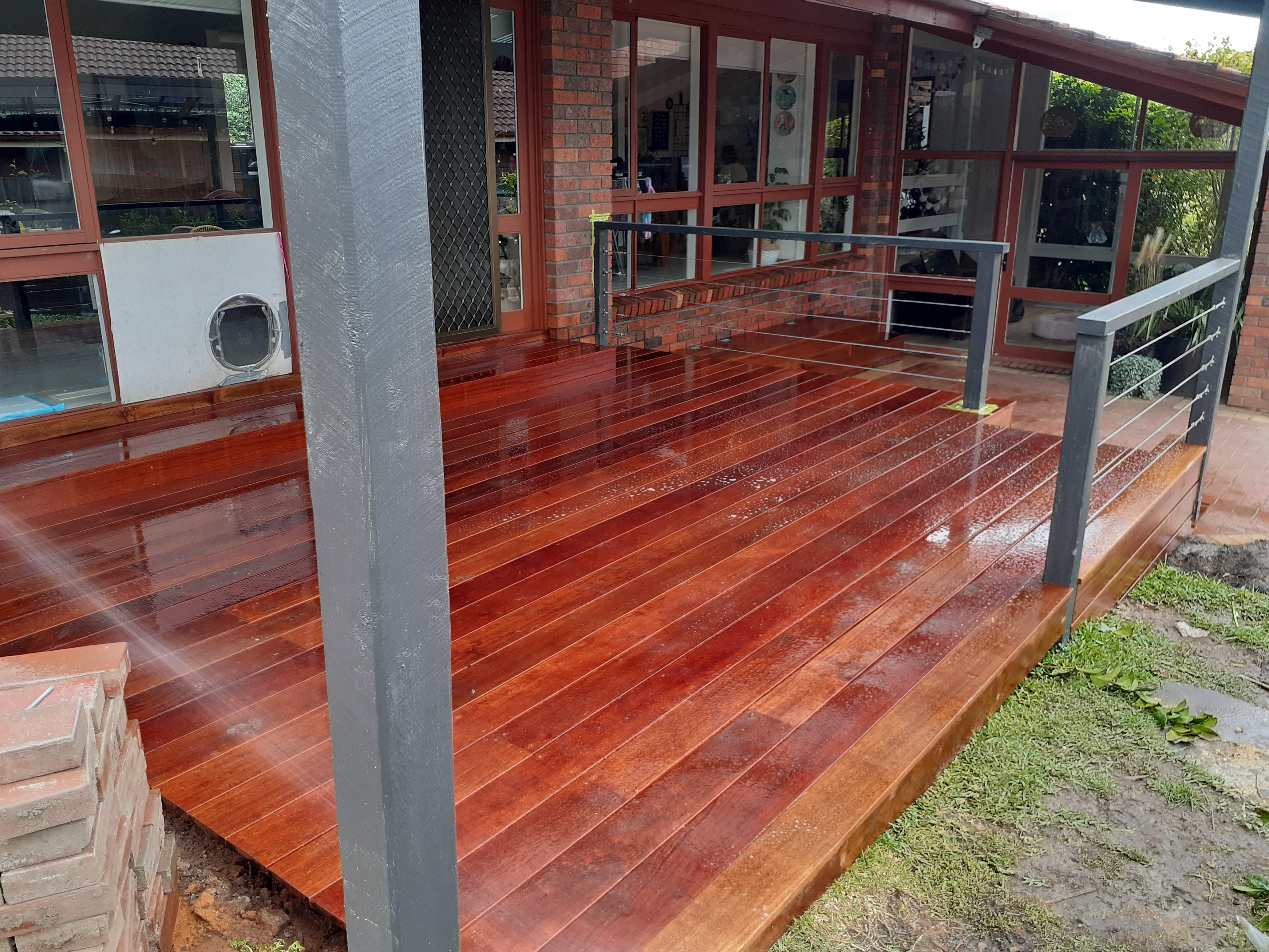 This client had a rotten existing deck. This one definitely makes the area much more usable.