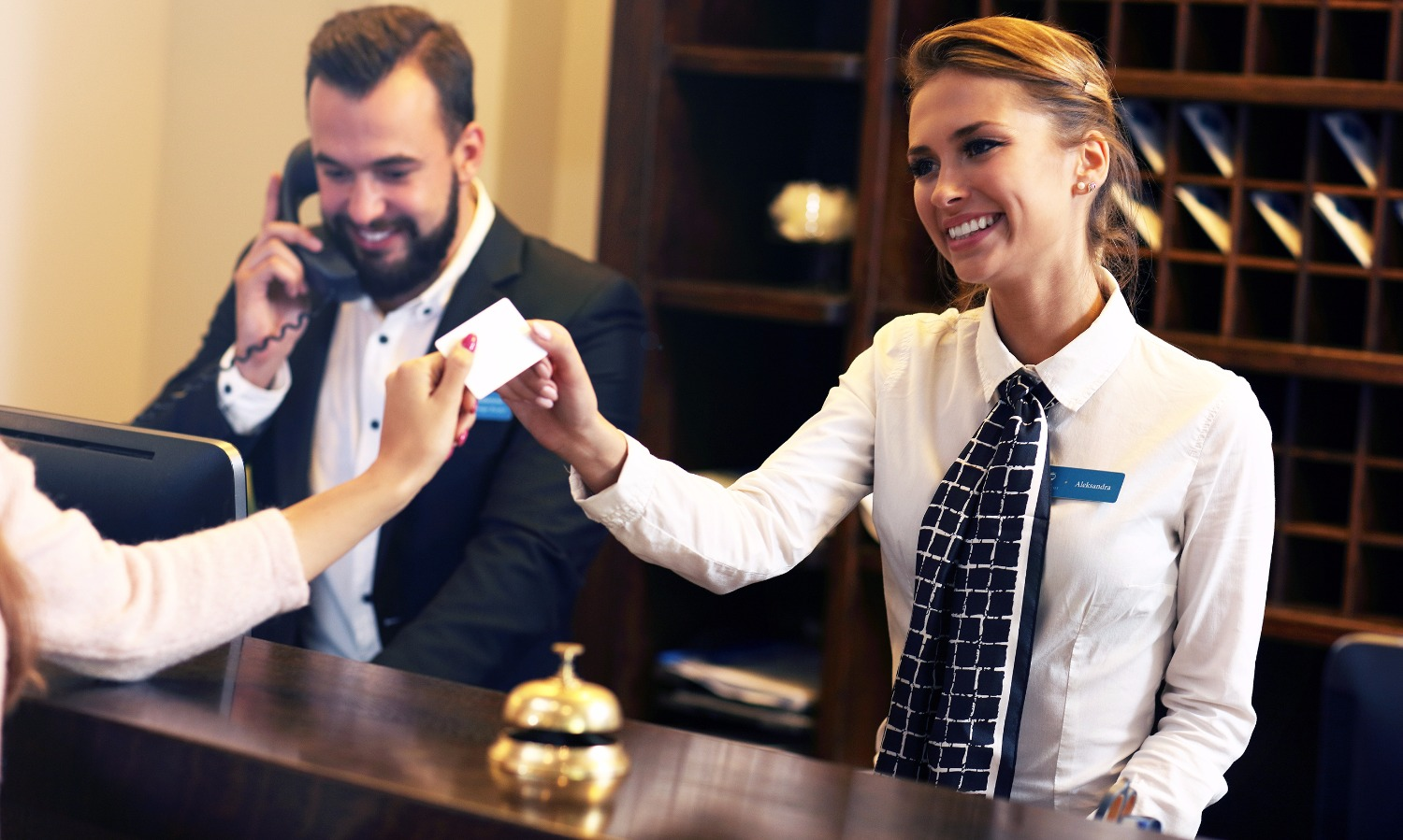 Picture of guests getting key card in hotel_edited