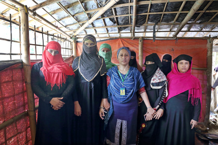 Razia Sultana welcomes newly arrived Rohingya women who will attend her psychosocial support and training program. ​ —Hakim Para Camp. Photo by Fabeha Monir.