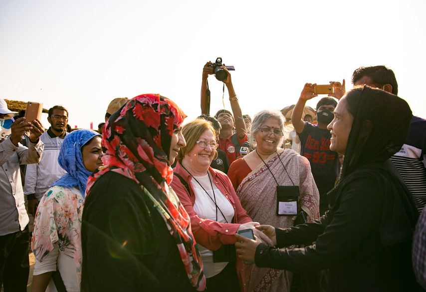 A Rohingya woman leader and Shireen Huq of the Bangladeshi women's organization Naripokkho, greet Nobel peace laureates Mairead Maguire and Tawakkol Karman. Naripokkho works to advance women's rights and equality and to build resistance against violence, discrimination and injustice. They have worked tirelessly to advocate for the needs of Rohingya women in Bangladesh.  —Kutupalong Camp. Photo by Alllison Joyce.