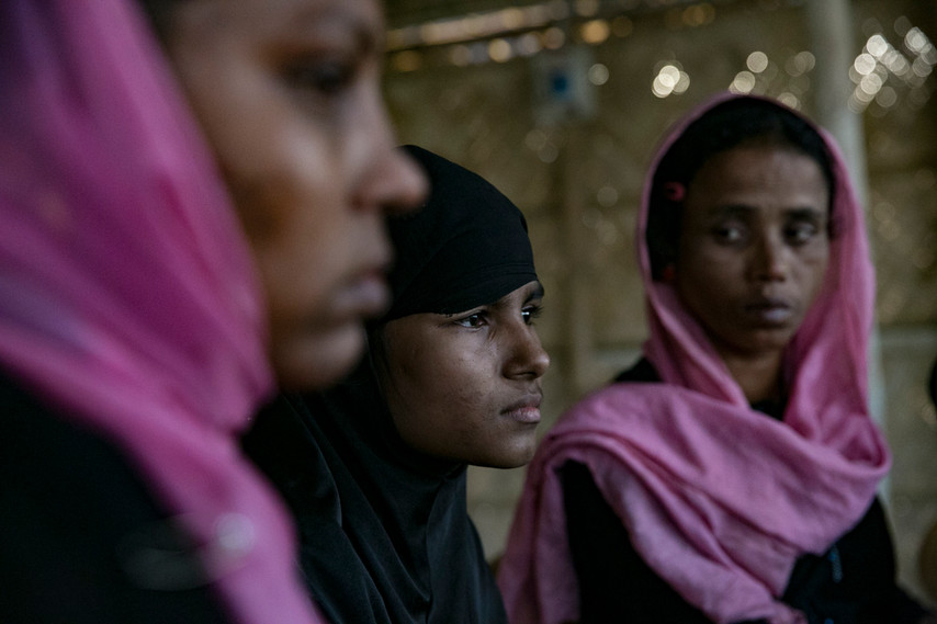 """""""I cannot walk because of the pain in my leg. I was carried here on a blanket tied to bamboo sticks. I wanted to come and talk to you.""""  —A Rohingya woman eight months pregnant, with a gunshot wound to her leg. Kutupalong Camp. Photo by Alllison Joyce."""