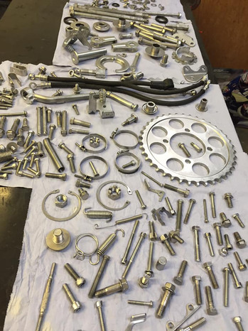 A motorbike's worth of nuts and bolts vapour blasted ready for rebuild