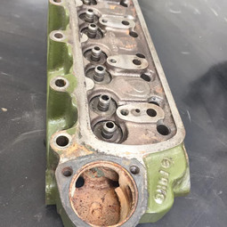 Cast Iron Mini cylinder head before Vapour blasting